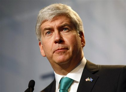 Michigan Governor Rick Snyder addresses the audience during the product launch of the 2012 Ford Focus vehicle at Ford Motor Co's Michigan As