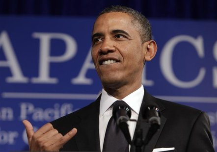 U.S. President Barack Obama gestures shaka at the Asian Pacific American Institute for Congressional Studies (APAICS) 18th annual gala dinne