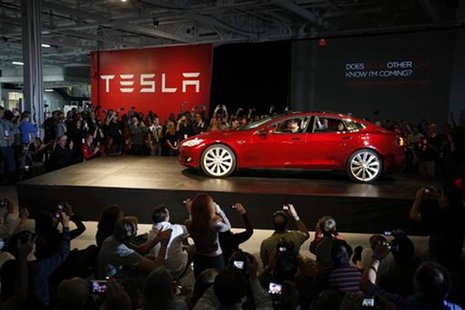 Tesla Motors CEO Elon Musk drives a Model S, the company's first full-size electric sedan, at the Tesla factory in Fremont, California Octob