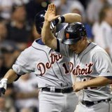 Detroit Tigers outfielder Andy Dirks (R) is congratulated by teammate Alex Avila. REUTERS/Frank Polich
