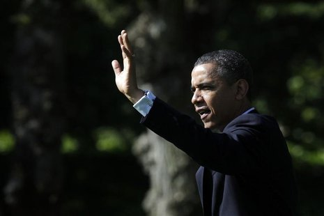 U.S. President Barack Obama waves as he walks out from the Oval Office of the White House in Washington May 10, 2012, before his departure t