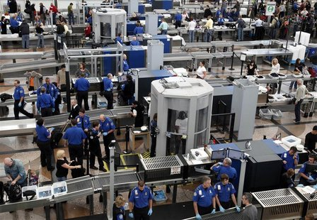 Transportation Security Agency (TSA) workers carry out security checks at Denver International Airport, the day before the Thanksgiving holi