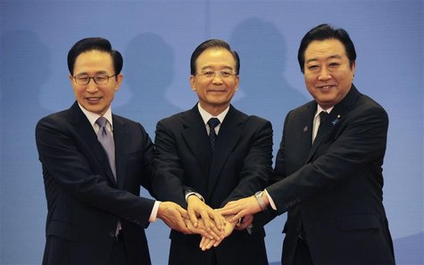 South Korea's President Lee Myung-bak (L), China's Premier Wen Jiabao (C) and Japan's Prime Minister Yoshihiko Noda hold their hands togethe