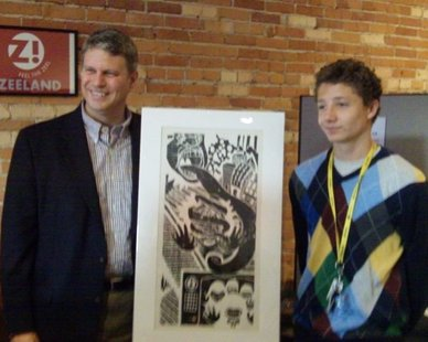 "US House Rep. Bill Huizenga (L, R-Zeeland) with West Ottawa High student Connor Bade (R) and his work ""An Exaggeration,"" which won the 2012 Congressional Art Competition for the 2nd District of Michigan on May 14, 2012."
