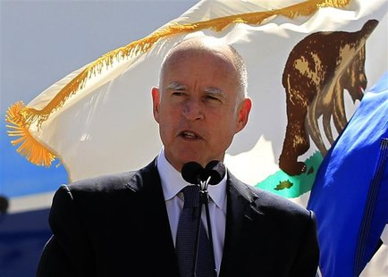 California Governor Jerry Brown speaks in front of a California flag in Long Beach, California March 14, 2012. REUTERS/Lucy Nicholson