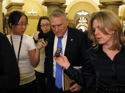 Super committee member Senator Jon Kyl (R-AZ) talks to reporters after a meeting with Republican committee members on Capitol Hill in Washin