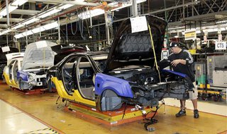 A General Motors assembly worker works on the production line for the 2011 Cadillac at the Grand River Assembly plant in Lansing, Michigan O
