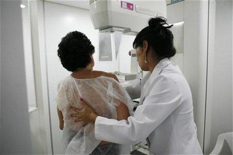 A woman undergoes a free mammogram inside Peru's first mobile unit for breast cancer detection, in Lima March 8, 2012. REUTERS/Enrique Castr