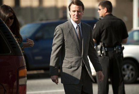 Former U.S. Senator John Edwards, 58, walks to the federal courthouse in Greensboro, N.C., May 7, 2012. REUTERS/Davis Turner