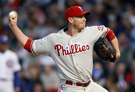 Philadelphia Phillies starting pitcher Roy Halladay throws against the Chicago Cubs in the first inning during their MLB National League bas