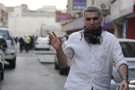 Bahrian's Human Rights Activits, Nabeel Rajab, gives a victory sign during an anti-government protest held in downtown Manama February 11, 2