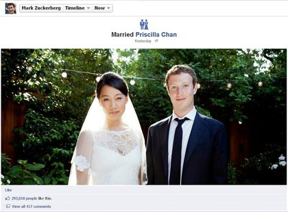 Facebook co-founder and CEO Mark Zuckerberg and Priscilla Chan are seen in this screengrab of a wedding photo posted on Zuckerberg's Faceboo