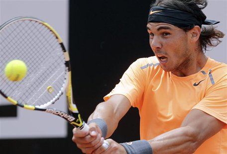 Rafael Nadal of Spain returns the ball to Novak Djokovic of Serbia during their men's singles final match at the Rome Masters tennis tournam