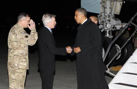 U.S. President Barack Obama shakes hands with U.S. Ambassador to Afghanistan Ryan Crocker upon his arrival at Bagram Air Base in Kabul, Afgh