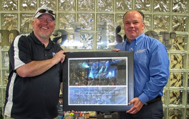 Dave Kallawy presenting Chuck Gahagan of Central Beer with a plaque for their sponsorship of the first 95-5 WIFC's Totally 80's for a Cause.