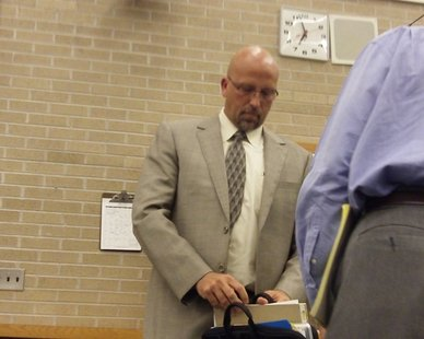 Zeeland School Superintendent Dr. Dave Barry prepares to leave a special Board of Education meeting on May 24, 2012, after he was suspended for two weeks by the panel for admitted plagiarism.