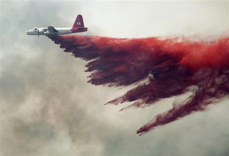 A Cal Fire aircraft drops flame retardant on the Topaz Ranch Estates Fire in Wellington, Nevada May 23, 2012. Evacuations were lifted today