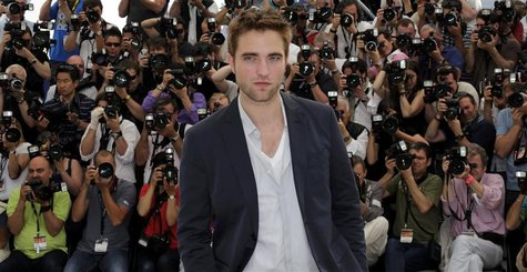 "Cast member Robert Pattinson poses during a photocall for the film ""Cosmopolis"", in competition at the 65th Cannes Film Festival May 25, 201"