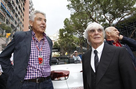 Formula One chairman Peter Brabeck-Letmathe (L) looks on next to Formula One commercial supremo Bernie Ecclestone during the Monaco F1 Grand