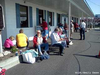 Michigan-bound passengers of the S.S. Badger ferry wait at the Manitowoc office for buses to return them to Michigan May 25, 2012. The ferry was being kept in Manitowoc as repairs were made to its engine. (courtesy of FOX 11).