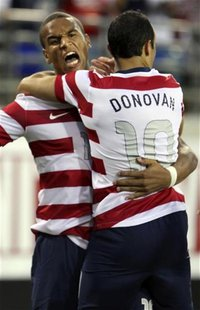 Landon Donovan (R) of the U.S. celebrates with teammate Terrence Boyd (L) after scoring against Scotland during their international friendly