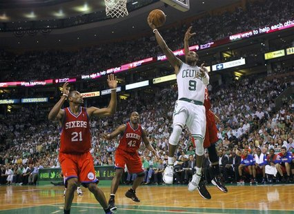 Boston Celtics point guard Rajon Rondo (9) drives to the net on Philadelphia 76ers' Thaddeus Young (L) during the second half of Game 7 of t