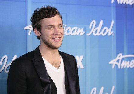 "Winner Phillip Phillips poses in the backroom after the 11th season finale of ""American Idol"" in Los Angeles, California May 23, 2012. REUTE"