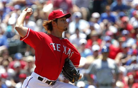 Texas Rangers pitcher Yu Darvish throws against the Toronto Blue Jays in the first inning of their MLB American League baseball game in Arli