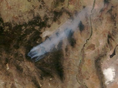 Wildfires burn in New Mexico's Gila National Forest in this NASA satellite image dated May 27, 2012. Diminished winds helped fire crews take