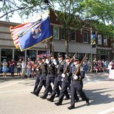 Members of the Holland Department of Public Safety's Police Honor Guard step out in the 2012 Holland Memorial Day Parade on May 28, 2012.