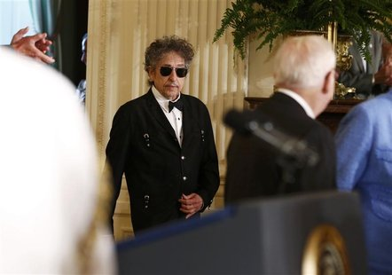 Musician Bob Dylan (C) arrives prior to receiving a Presidential Medal of Freedom in the East Room of the White House in Washington, May 29,