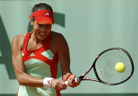 Ana Ivanovic of Serbia returns the ball to Shahar Peer of Israel during the French Open tennis tournament at the Roland Garros stadium in Pa
