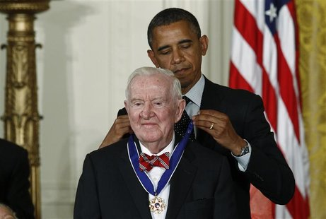 U.S. President Barack Obama awards a 2012 Presidential Medal of Freedom to former Associate Justice of the U.S. Supreme Court John Paul Stev