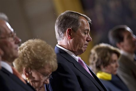 U.S. House Speaker John Boehner (R-OH) lowers his head during an event to commemorate Holocaust victims and survivors in the Capitol Rotunda