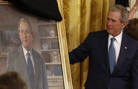 Former U.S. President George W. Bush unveils his official White House portrait during a ceremony in the East Room of the White House in Wash