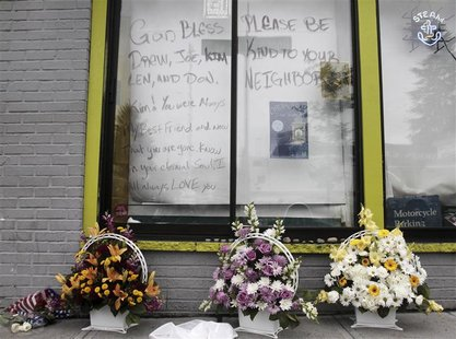 Flowers sit outside the Cafe Racer after Wednesday's deadly shooting incident in Seattle, Washington, May 31, 2012. A gunman killed four peo