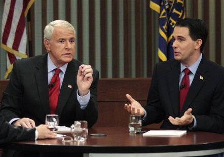 Democratic challenger and Milwaukee Mayor Tom Barrett (L) and Republican Wisconsin Governor Scott Walker, who is facing a recall election, t