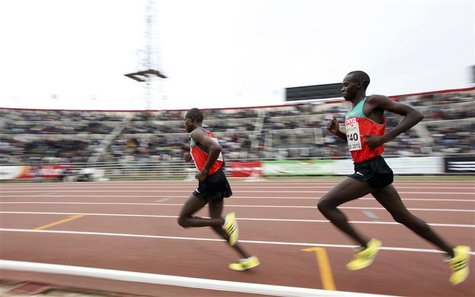 Wilson Kiprop (R) of Kenya races against compatriot Matthew Kisorio during the 10,000m men's final race at the 2010 African Athletics Champi