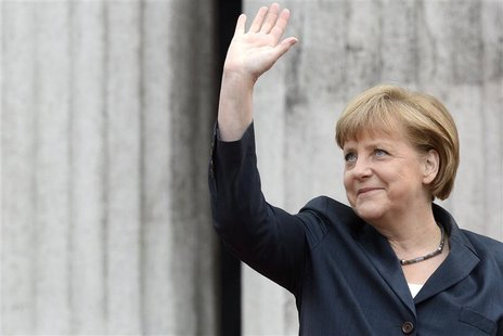 "German Chancellor Angela Merkel waves to spectators during the arrival for the ""Council of the Baltic Sea States"" summit in Stralsund, May 3"