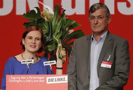 Katja Kipping (L) and Bernd Riexinger, new leaders of Germany's left wing Die Linke party, stand on stage after being elected at a federal p