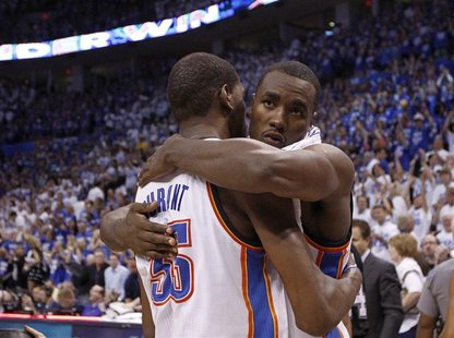 Oklahoma City Thunder power forward Serge Ibaka (R) hugs teammate Kevin Durant (35) after defeating the San Antonio Spurs following Game 4 o