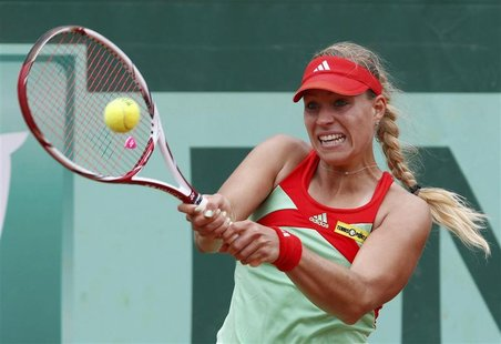 Angelique Kerber of Germany returns the ball to Petra Martic of Croatia during the French Open tennis tournament at the Roland Garros stadiu