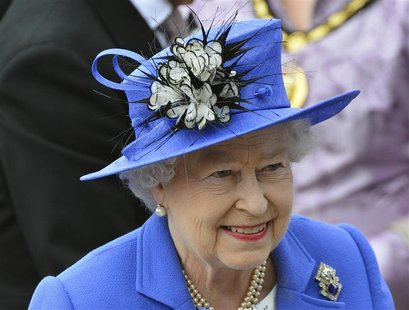 REFILE - ADDING THE WORDS 'DIAMOND JUBILEE' IN CAPTION Britain's Queen Elizabeth arrives at the Epsom Derby festival in Epsom, southwest of