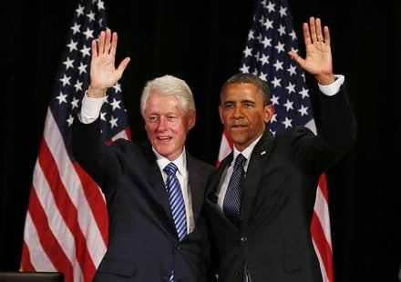 Former U.S. President Bill Clinton (L) and U.S. President Barack Obama wave at a fundraiser, at the Waldorf Astoria in New York June 4, 2012