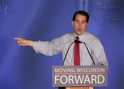 Republican Wisconsin Governor Scott Walker (C) celebrates his victory in the recall election against Democratic challenger and Milwaukee May