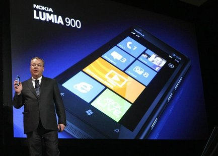 Nokia CEO Stephen Elop displays the Nokia Lumia 900 smartphone at the Consumer Electronics Show opening in Las Vegas January 9, 2012. REUTER