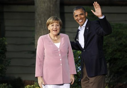 President Barack Obama greets Germany's Chancellor Angela Merkel as she arrives at the G8 Summit at Camp David, Maryland, May 18, 2012. REUT