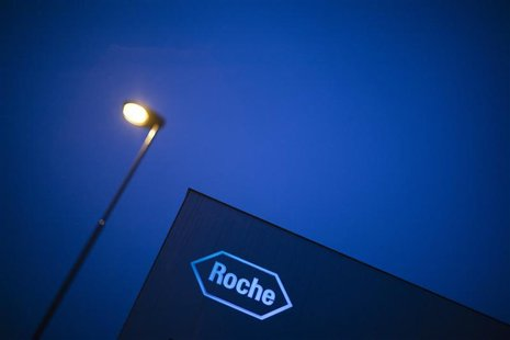 A logo of Swiss pharmaceutical company Roche is pictured in front of a company's building in Rotkreuz, April 12, 2012. Swiss drugmaker Roche