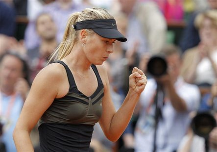 Maria Sharapova of Russia reacts during her women's singles final match against Sara Errani of Italy at the French Open tennis tournament at
