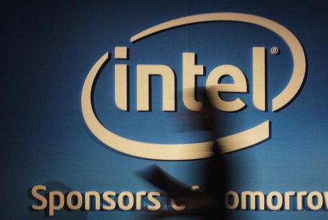 A woman walks past an Intel logo at the 2012 Computex consumer electronics trade fair in Taipei in this June 5, 2012 file photo. The world o